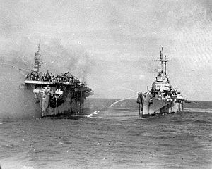 Schrott USS_Birmingham_comes_alongside_the_burning_USS_Princeton